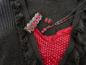 Assortment of sparkling red jewelry