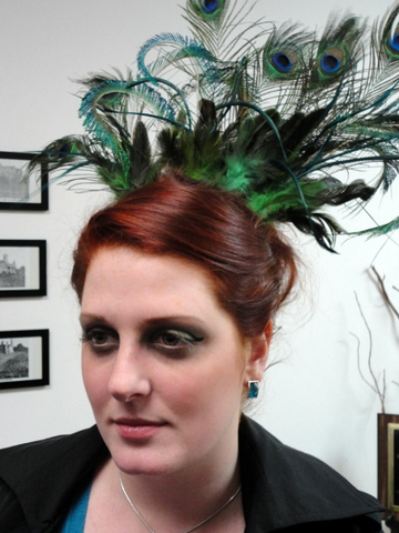 Abby in a peacock-inspired up-do