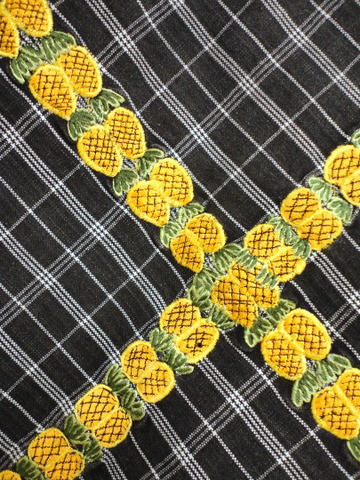 Love the rows of pineapples on the skirt!