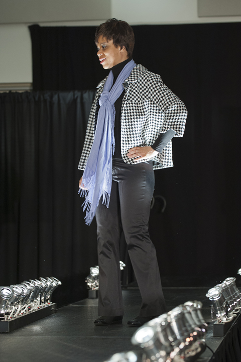 Ursuline student Erica Williams paired this Banana Republic black sweater and boot-cut stretch satin pants with a black and white houndstooth blazer and lilac scarf (total cost $23) (Photo: Stephen Travarca)