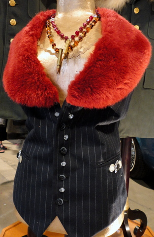 Red faux fur gives this pinstripe vest a dramatic look