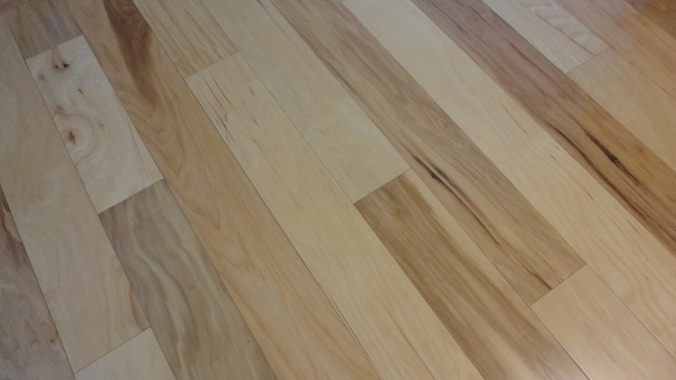 The kitchen flooring was new. It's engineered hickory, and quite nice looking.