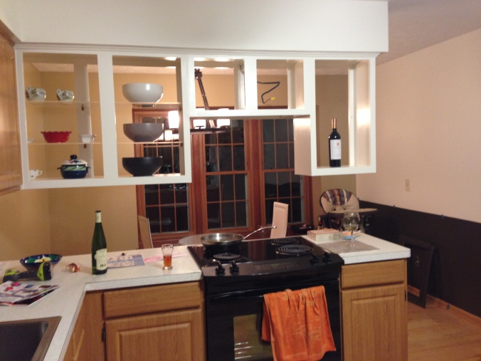 We painted the cupboard frames with Swiss Coffee and immediately filled them with decorative glassware ... and wine.