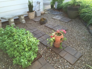 Next we placed pavers in a simple pattern, filled the space with river rock.