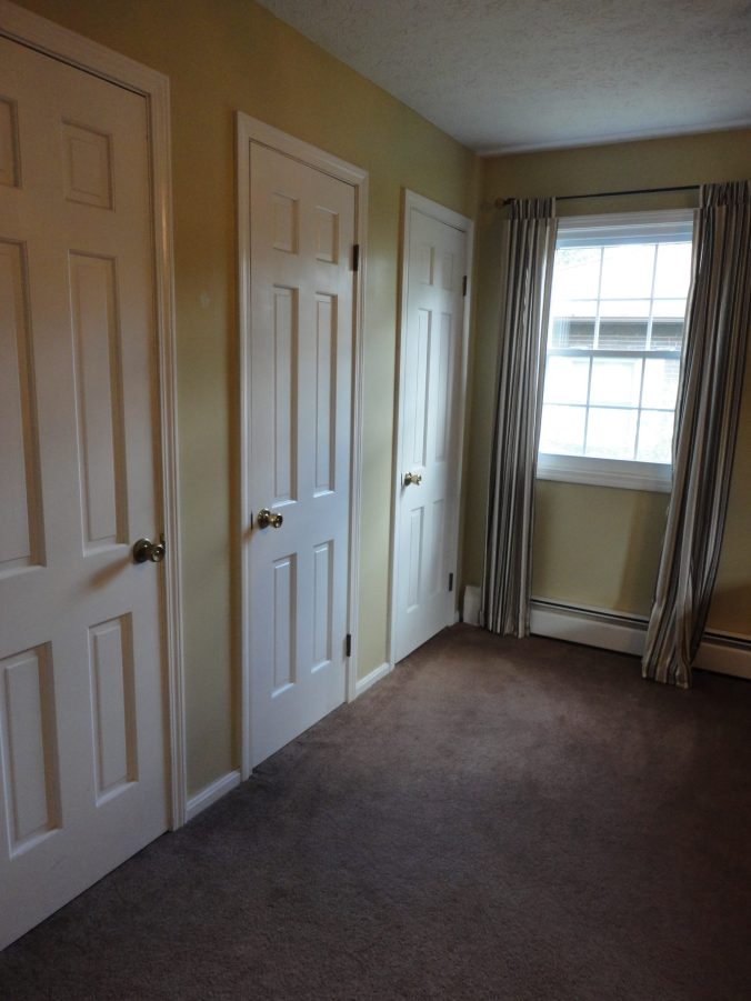 bedroom down three closets