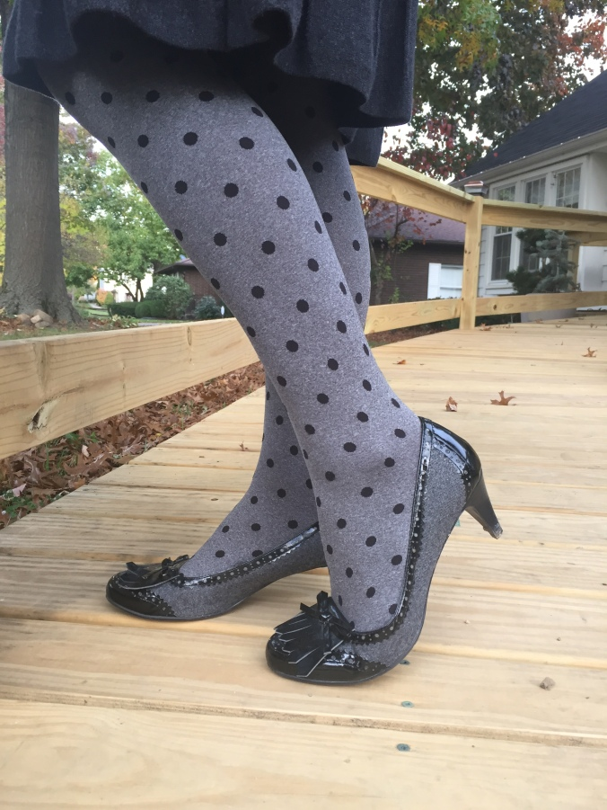 Close up of Elle's black/grey polka dot tights