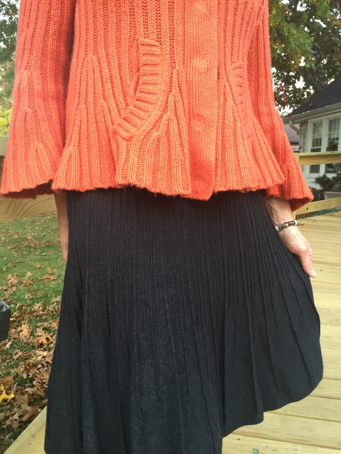 Close up of Elle's ribbed skirt and sweater