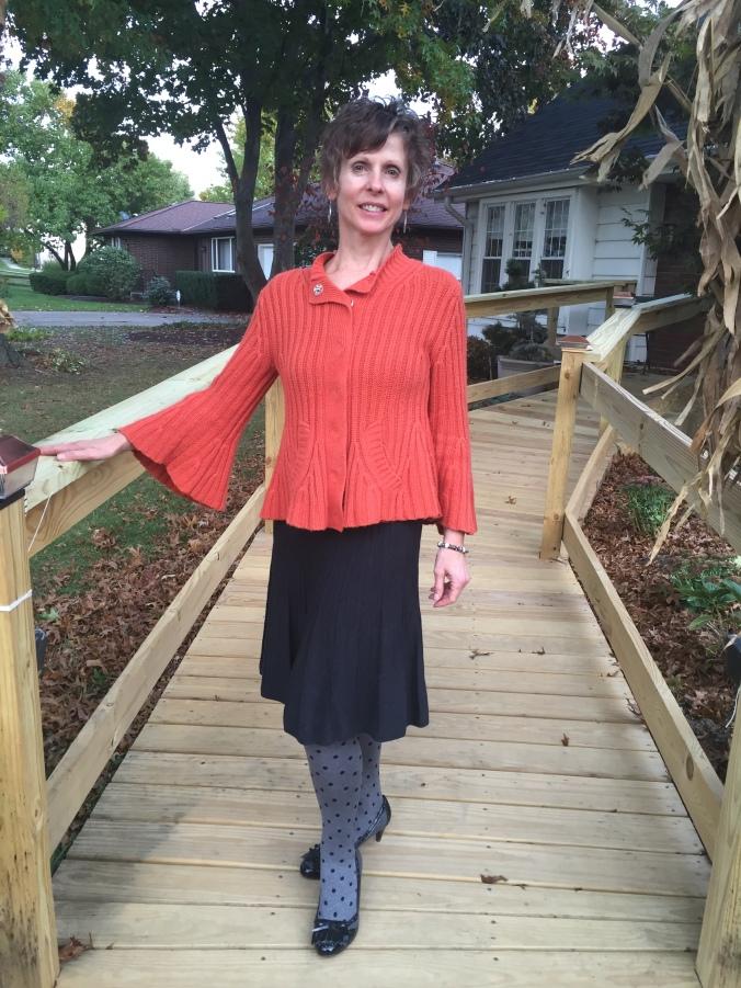 Elle in orange/grey outfit 2