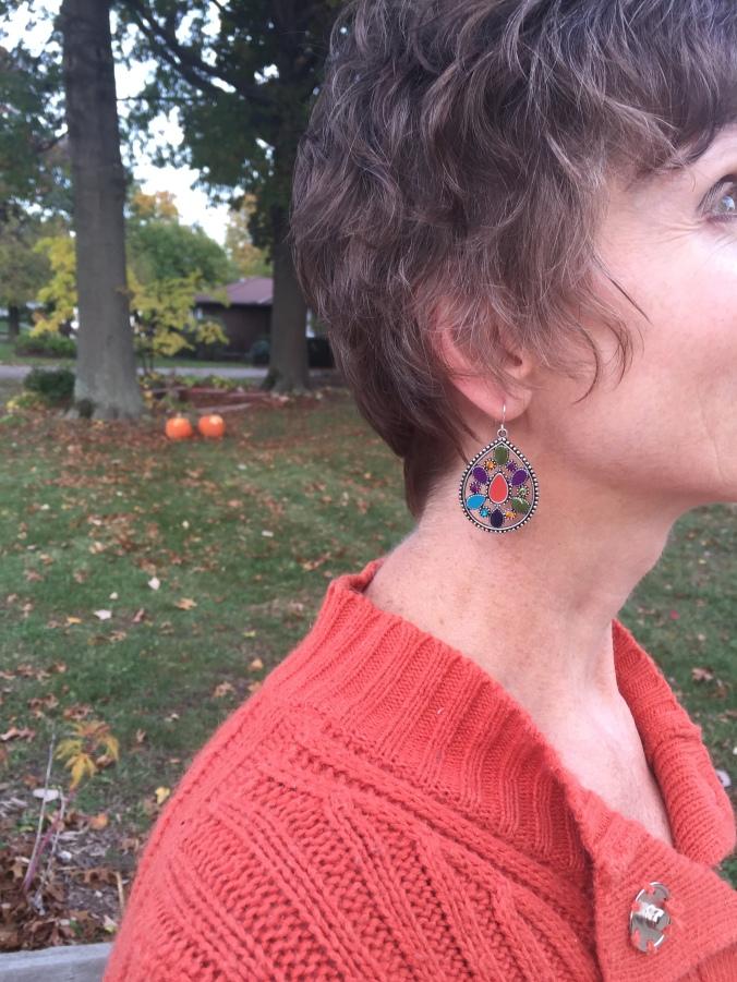 Close up of Elle's enameled earring