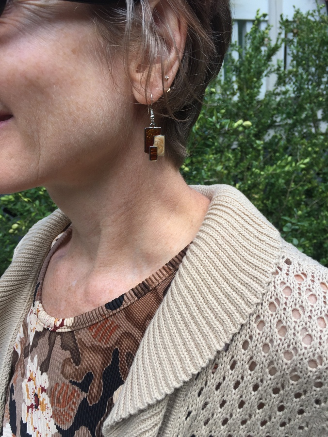 Elle wearing earrings from Wish